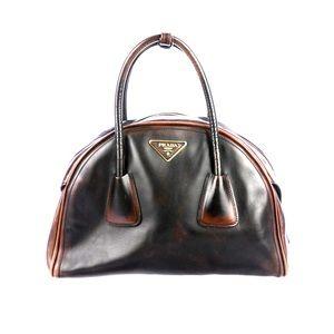 Walnut distressed Prada Bowler Bag.